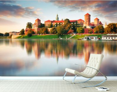 Wawel hill with castle in pink light of sunset, Krakow, Poland