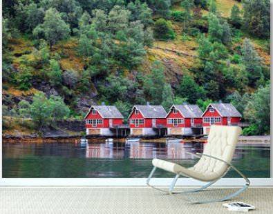 Reflection of a small houses in norwegian fiord