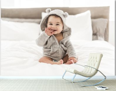 Portrait of a baby boy on the bed in bedroom