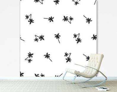 Seamless pattern of small black palm trees on a white background