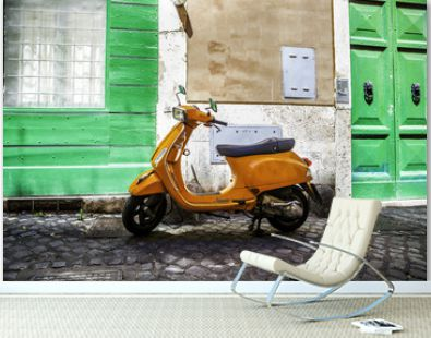 Typical street scene in Rome with a red scooter on an old narrow cobblestoned street. Scooter Vespa parked on old street in Rome, Italy