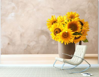 Jug with beautiful yellow sunflowers on table