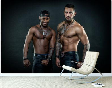 Machos with muscular tattooed torsos look attractive, dark background. Masculinity concept. Guys sportsmen with sexy muscular torsos. Athletes on confident faces with nude muscular chests