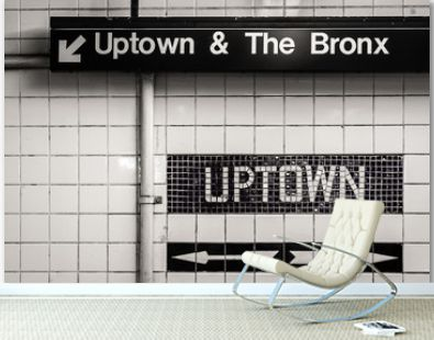 Uptown and The Bronx sign in a subway station in Manhattan, New York City