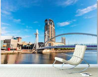 Modern buildings at Salford Quays with vertical lift Millennium Footbridge.