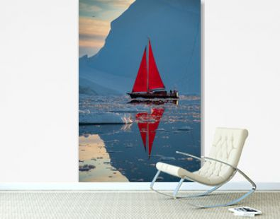 Greenland midnight Sunset iceberg calm mirror ocean with red sail ship reflected