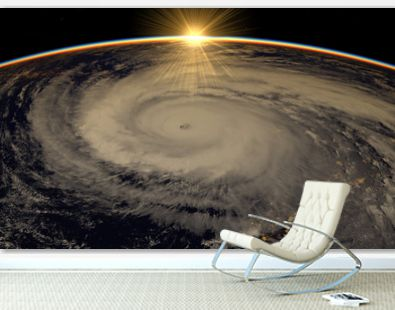 Hurricane visible above the earth, satellite view. Elements of this image furnished by NASA.
