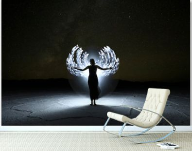 Light Painted Long Exposure Image of a Woman with the Milky Way