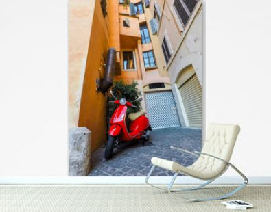 Rome, Italy - July 8, 2018: Scooter Vespa parked on old street in Rome, Italy. Scooter parked in narrow old street of Rome in Trastevere neighborhood.