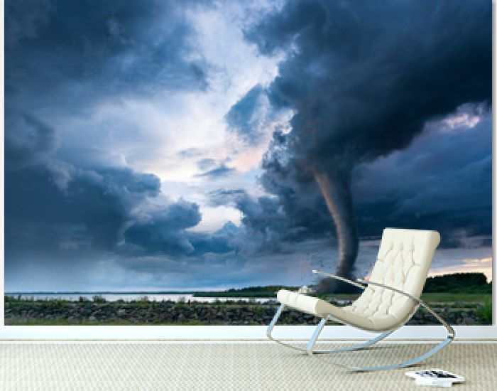 Tornado or twister storm clouds going over landscape and a ranch farm house destroying everything on it's way.