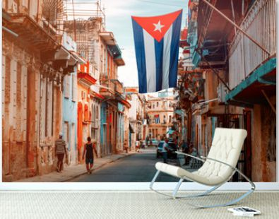 Cuban flags, people and aged buildings in Old Havana