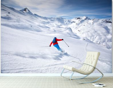 Young attractive skier skiing in famous ski resort in Alps, Livigno, Italy, Europe
