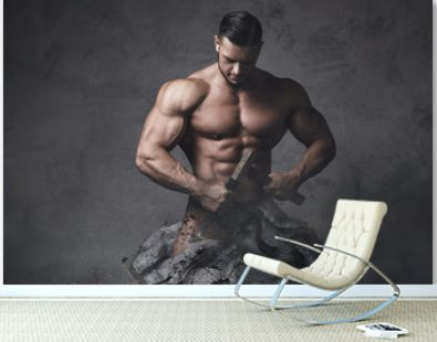 Bodybuilder made himself from the piece of stone. Concept of self improvement and bodybuilding progress.