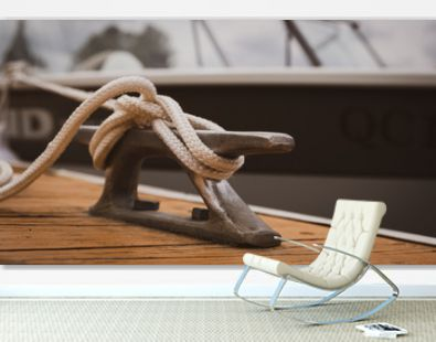 docked boat tied with nautical rope and knot