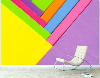 An abstract geometric textured background of multicolored rainbow colors created with overlapping foam craft paper