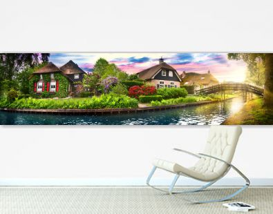 Landscape of Giethoorn village with water canals and rustic houses in netherland wide banner or panorama.