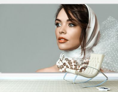 Portrait of young sensual romantic brunette woman in white stylish hood, jewelry beads accessories