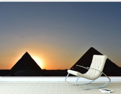 beauty  sunset background of pyramids giza  CAIRO EGYPT.Silhouette pyramids when sunset and orange sky
