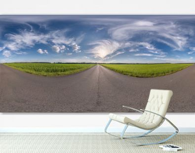 Full spherical seamless panorama 360 degrees angle view on no traffic old asphalt road among fields with clear sky and white clouds in equirectangular projection, VR AR content