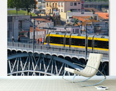 Porto, Portugal - July 18, 2019: Subway passing by Dom Luis I bridge towards Vila Nova de Gaia.