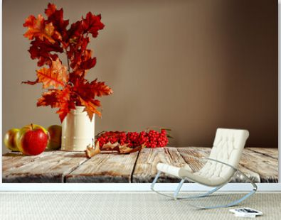 Autumn table with colorful leaves on an afternoon day