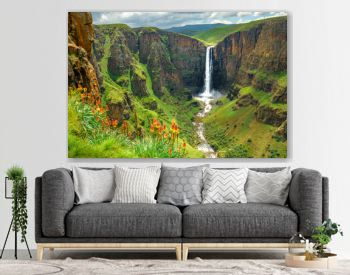 Maletsunyane Falls in Lesotho Africa. Most beautiful waterfall in the world. Green scenic landscape of amazing water fall dropping into a river inside canyons. Panoramic views over the great falls.