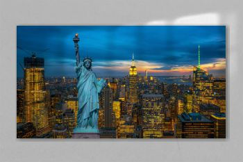The Statue of Liberty over the Scene of New York City cityscape in lower manhattan at the twilight time,Architecture and building with tourist concept, United state of America, USA