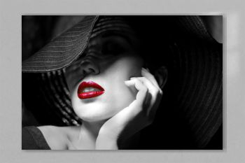 Mysterious woman in black hat. Red lips