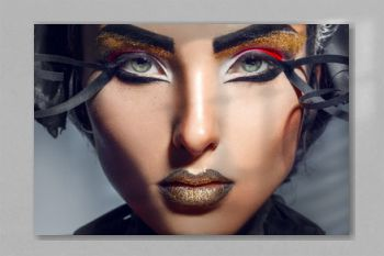 Close up portrait of charming adult woman with gold lips