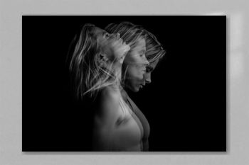 Beautiful dramatic phantom mystical mysterious ambiguous original conceptual profile side portrait of young blonde woman on a black background. Black and white photo. triple exposure.