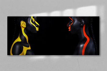Woman with black body paint. Cheerful young african girl with art bodypaint. An amazing model with yellow and red makeup. Closeup face with copy space.