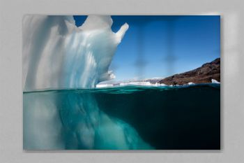 Underwater view of icebergs in Scores Bysund Fjord, east Greenland.