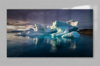 Greenland midnight sunset with heavy clouds mirror panorama