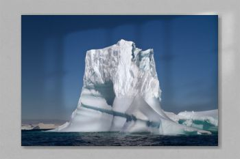 large iceberg in Antarctic waters on a sunny summer day