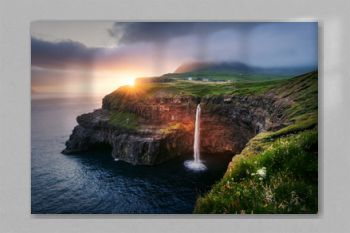 Incredible sunset view of Mulafossur waterfall in Gasadalur village, Vagar Island of the Faroe Islands, Denmark. Landscape photography