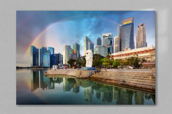 SINGAPORE - OCTOBER 11: Singapore - Merlion fountain with rainbow in front of the Marina Bay Sands hotel at sunrise