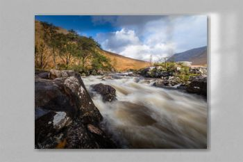 long exposure shot of the waterfalls in glen etive near loch etive and the entrance to glencoe and rannoch moor in the argyll region of the highlands of scotland during autumn