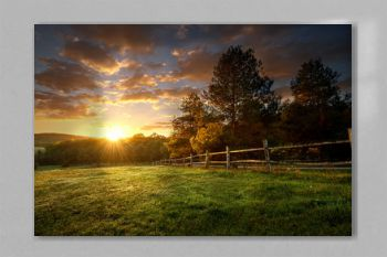 Picturesque landscape, fenced ranch at sunrise