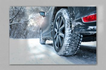 Snowy country road with car on winter day, closeup. Space for text