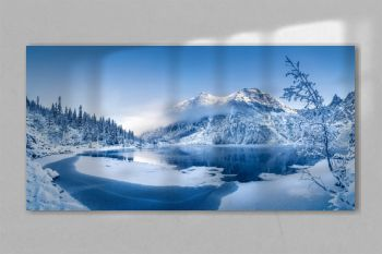 Winter panoramic landscape with scenic frozen mountain lake