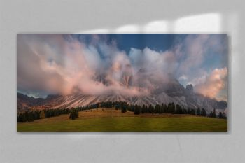 The Dolomites Geisler Odle mountain peaks covered by clouds. Scenic landscape. South Tyrol, Northern Italy