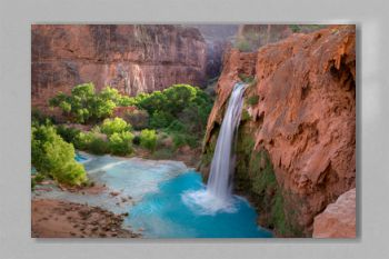A view of Havasu Falls from the hillside above the falls. The turquoise colored water flowing in to the pool below is surreal and one of a kind in the desert of Arizona