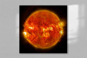 NASA's Solar Dynamics Observatory captured images of the sun emitting a mid-level solar flare. Original from NASA