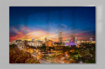 Sandton city at night with twilight and stars in the sky