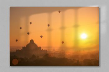 Hot air balloon over plain of Bagan in misty morning