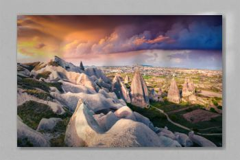 Unreal world of Cappadocia. Dramatic sunrise in Red Rose valley in April. Cavusin village located, district of Avanos in Nevsehir Province in the Cappadocia region of Turkey, Asia.