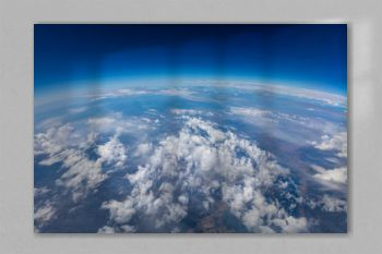 Curvature of planet earth. Aerial shot. Blue sky and clouds