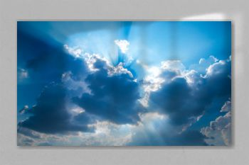Rays of light with dramatic sky. Cumulus sunset dark clouds with sun setting down on dark background.Vivid orange and blue cloud sky.