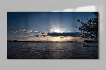 Sunset panorama, beam over cloud, above lake, sun rays over clouds, scenic evening with sun