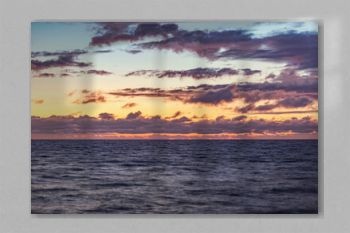 Sunset sky over the surface of the sea.